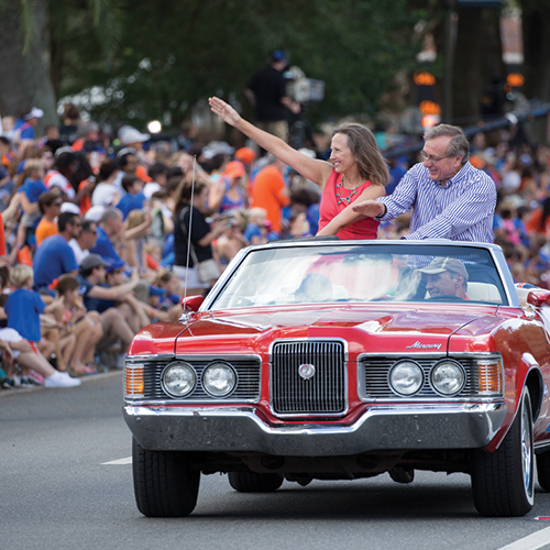Photo of President Fuchs in convertible during UF Parade