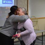 photo of ufhr's kenya williams hugging heo recipient