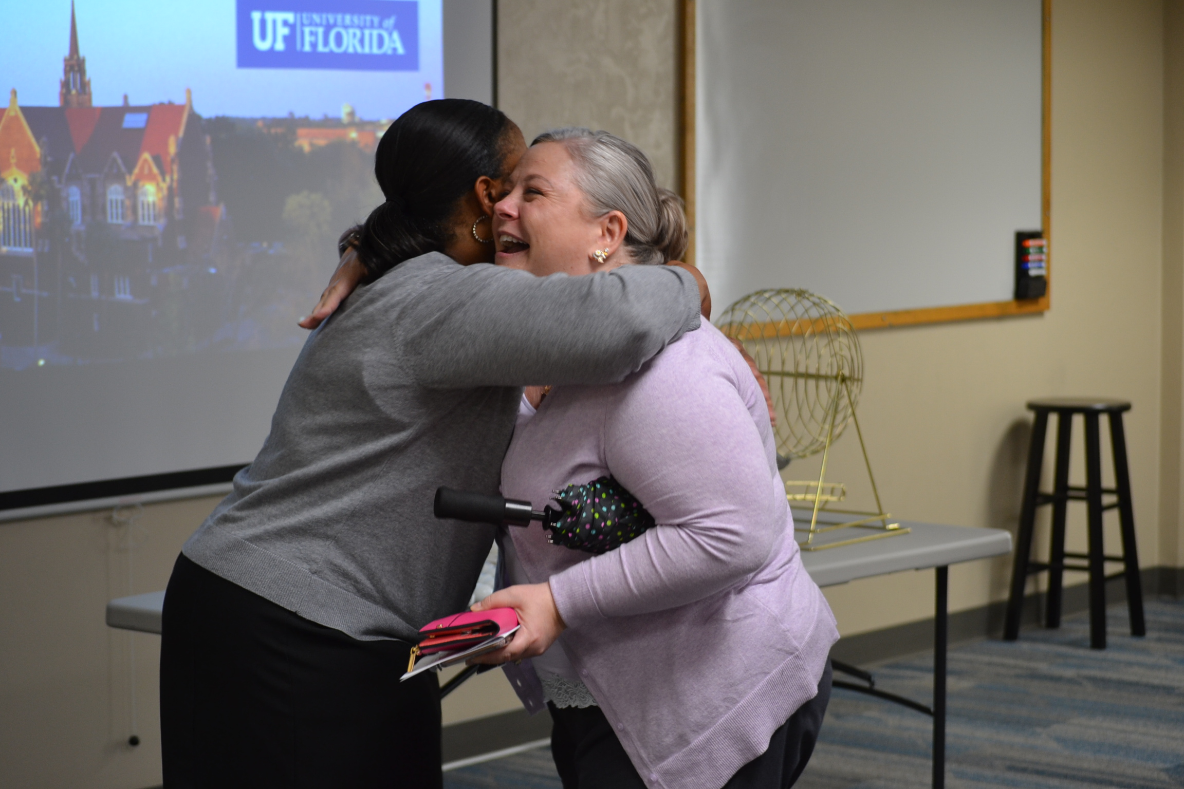 photo of ufhr's kenya williams hugging heo recipient