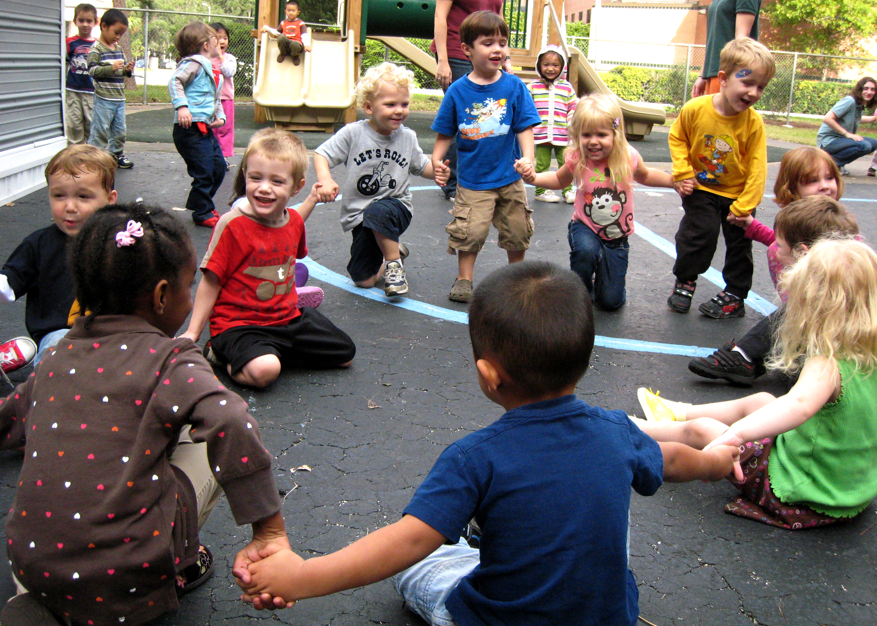 children playing ring around the rosie outside