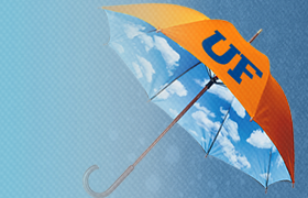 open orange umbrella with UF in blue and blue background