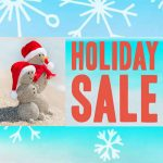 holiday sale image with snowflakes and sandmen with santa hats
