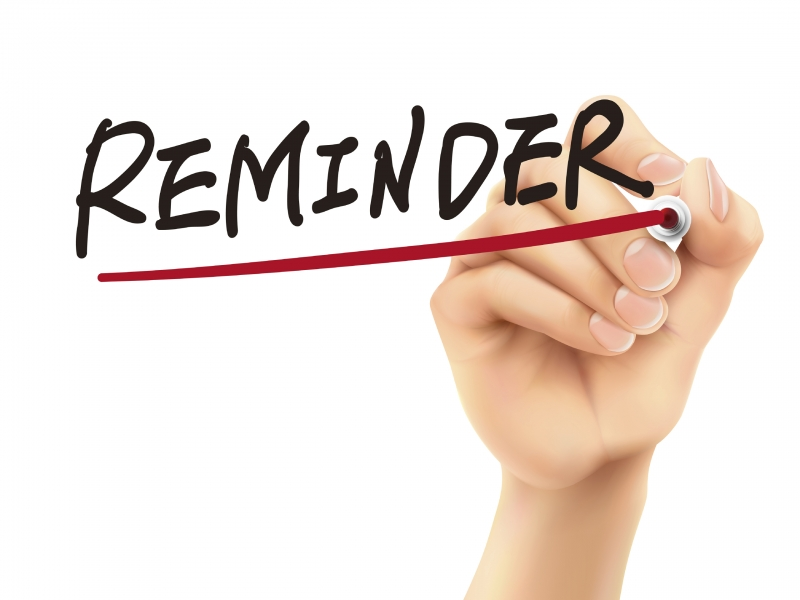 hand writing and underlining the word reminder