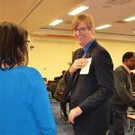 ufln speaker talking to event attendee