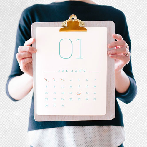 Image of a person holding calendar with checked dates