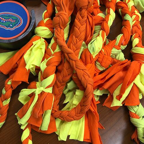 orange and yellow dog rope toys