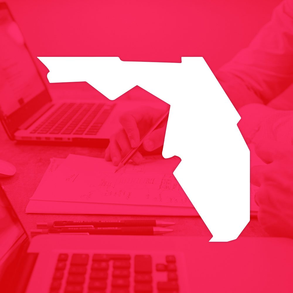 florida outline in white over red background