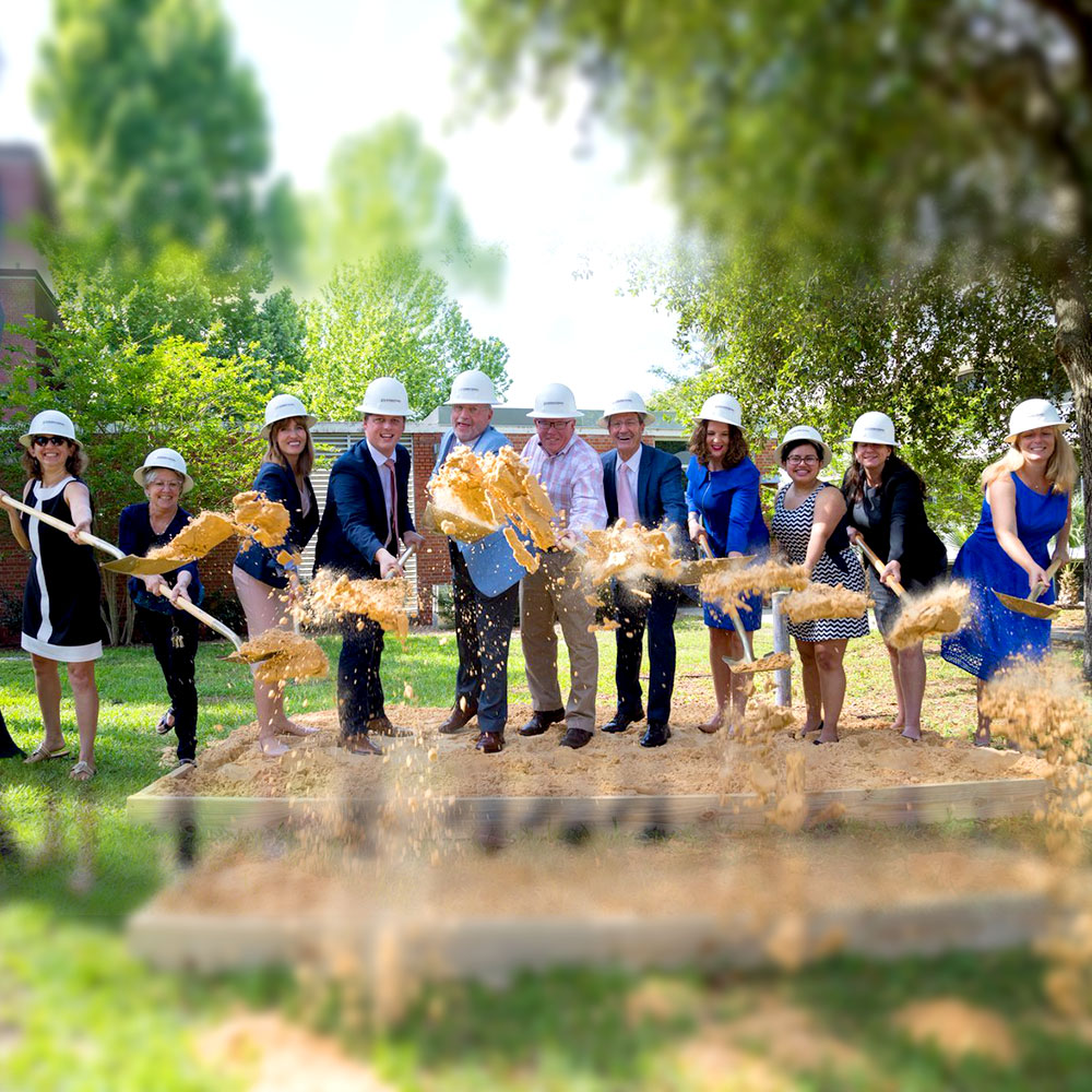 field and fork expansion groundbreaking stakeholders tossing dirt