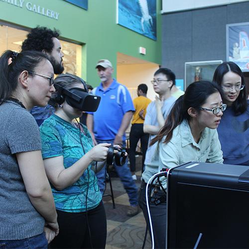 students at vr demo day at the florida museum of natural history