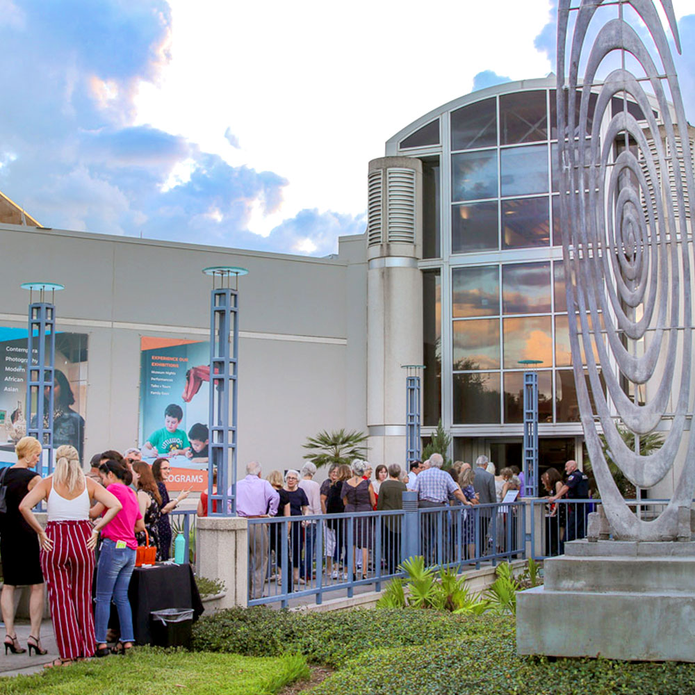 people lined up outside of the harn museum of art