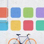 wellness logo above bicycle