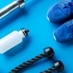 Men's Health: Exercise equipment on blue background