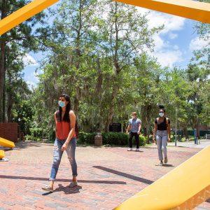 Students wearing masks while walking through campus