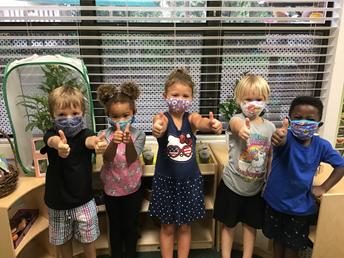 Baby Gators (children) wearing masks