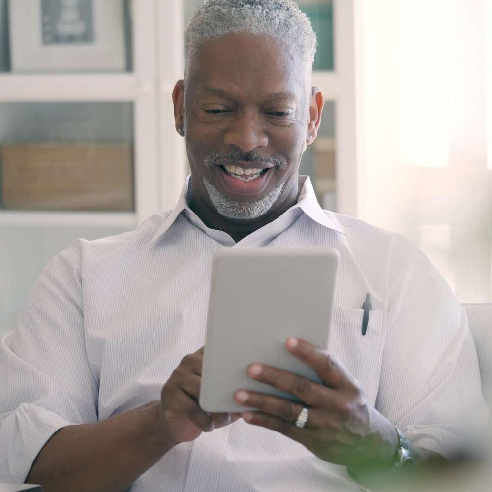man with an ipad